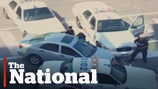 Toronto police open fire on car