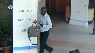 Man caught on camera stealing a AU official's belongings