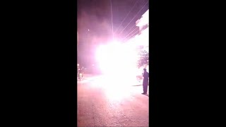Electric Pole Catches Fire in the Street at Night