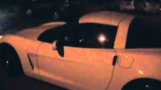 a manual corvette car starting up and driving off from my neighbour hood in edmonton at night