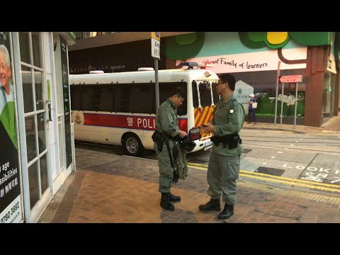 Security presence at Beijing Liaison office beefed up in HK on China's National Day | AFP