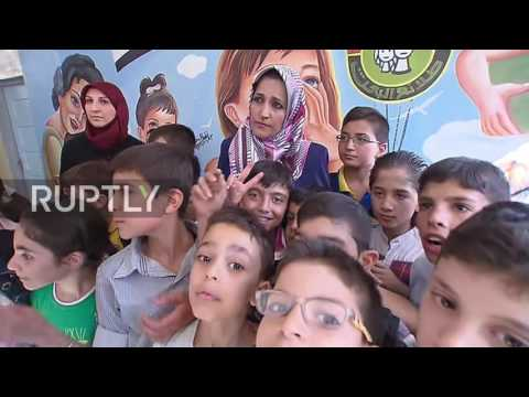 Syria: Syrian troops remove mortar shell from Aleppo school roof