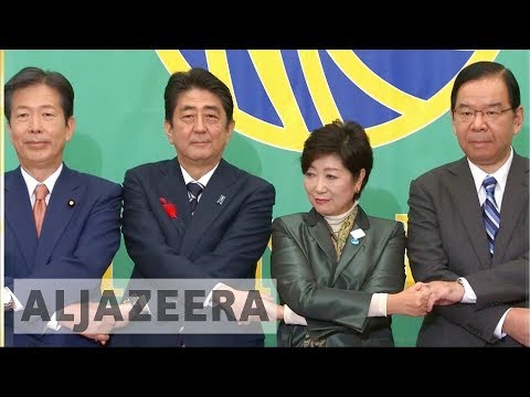 Japan's Abe faces challenges from new political parties in snap election
