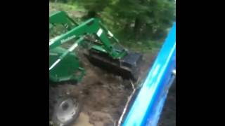 Tractors digging ditch.