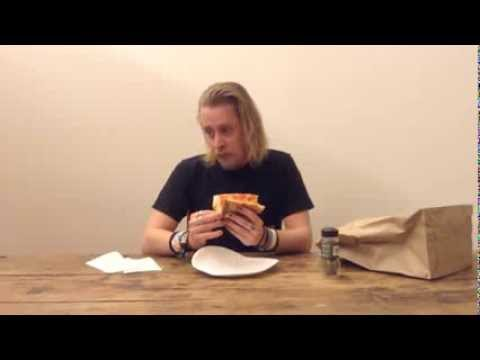 Macaulay Culkin Eating a Slice of Pizza