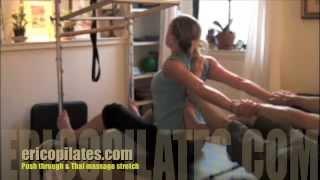 Push through on Pilates Cadillac & Thai massage Stretch - Pilates Chelsea NYC
