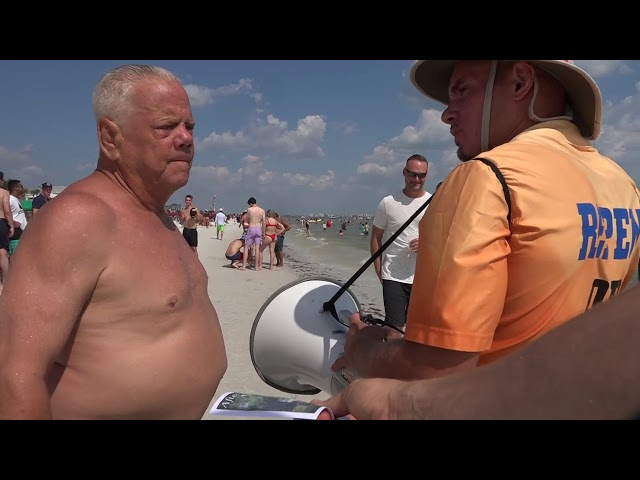 Beach Goers Blessed by Bible