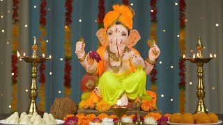 Moving close shot of Lord Ganesha Idol for Ganesh Chaturthi - Colorful festive background