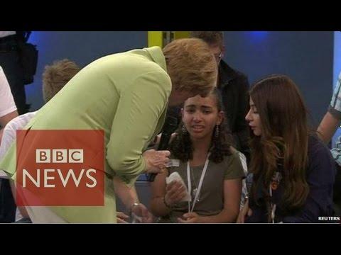 Angela Merkel criticised over crying refugee - BBC News