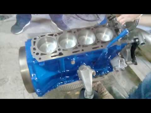Mercedes Benz W123, M102 engine assembly.
