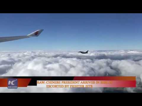 Raw: Chinese  president arrives in Berlin, escorted by fighter jets