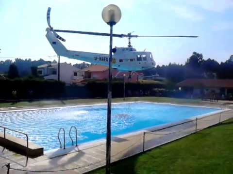 Helicopter refills its water bucket from a public swimming p