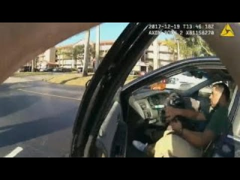 Cop clings to speeding car as suspect flees