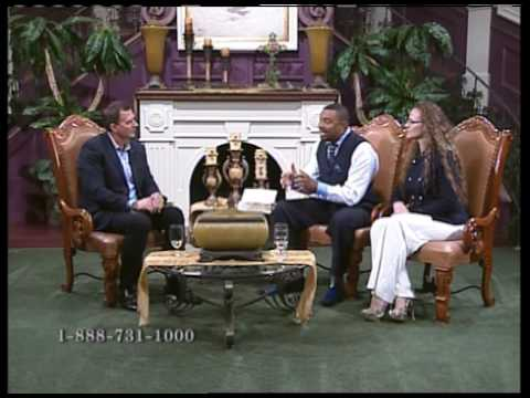 Pastor Greg Brown with Bishop C.L. and Lisa Mitchell