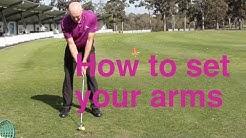 Arms set at address