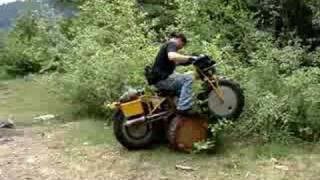 Riding a Rokon over a log round.