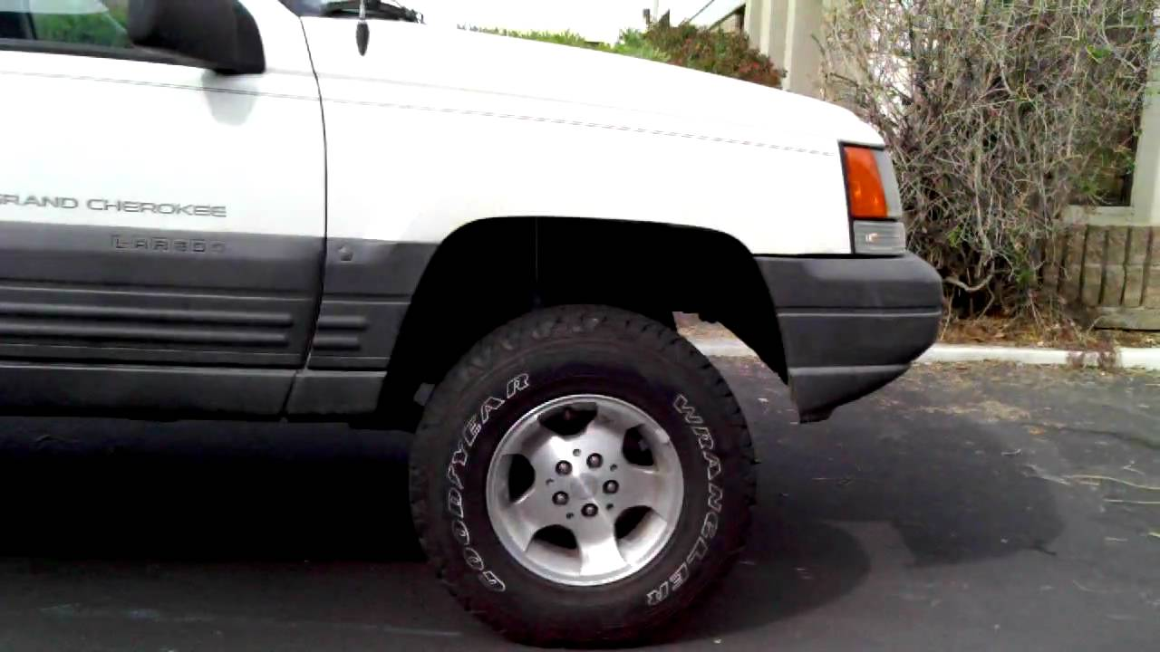 Zj jeep grand cherokee lift kit with new coil springs and shocks zj jeep grand cherokee lift kit with new coil springs and shocks youtube sciox Image collections