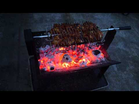 THE WEDGE Fire Pit Showing The Muti Adjustable Rotisserie Basket.