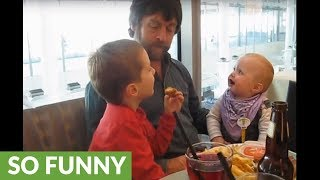 Dad eating french fries sends baby into giggle fit