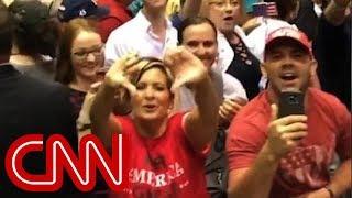 Trump supporters flip CNN the bird