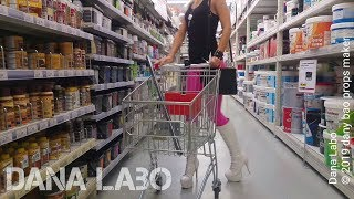 DANA LABO Shopping And Catwalk In Vinyl Leggings And Shiny Boots
