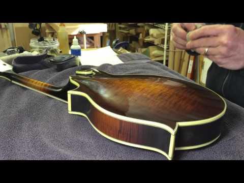 French polishing a Clark F5 mandolin