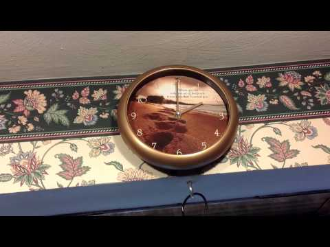Foot prints in the sand Musical wall clock