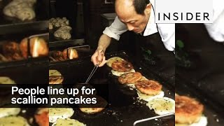 people line up in the middle of the night for scallion pancakes