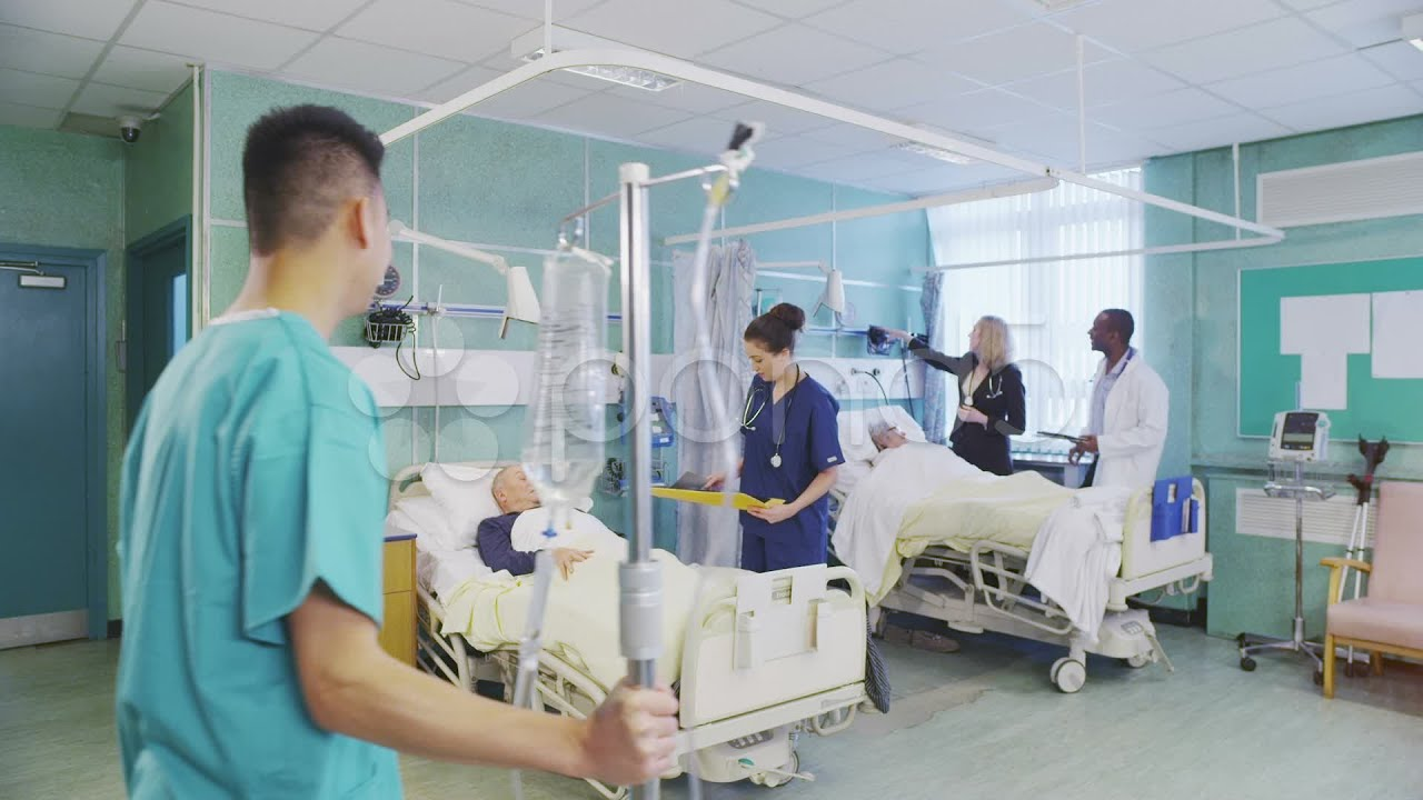 Busy Doctors And Nurses Taking Care Of Patients On A ...