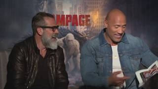 The Rock & Jeffrey Dean Morgan laugh at an old photo of The Rock, Rampage, John Cena