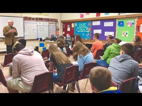 Veteran of the FBI, Jim Sacia, speaks at Winnebago Middle School Career Day