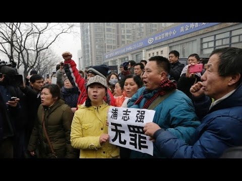 Scuffles as Chinese rights lawyer stands trial