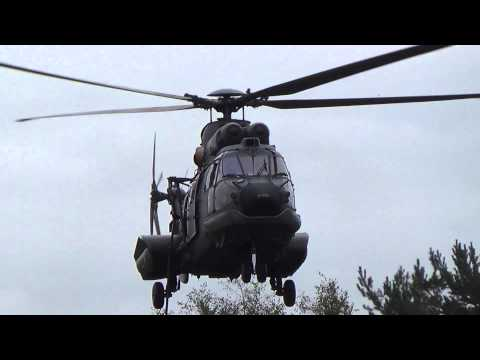 Fast rope training and lowpass RNLAF Eurocopter AS532 Cougar at Arnhemse Heide
