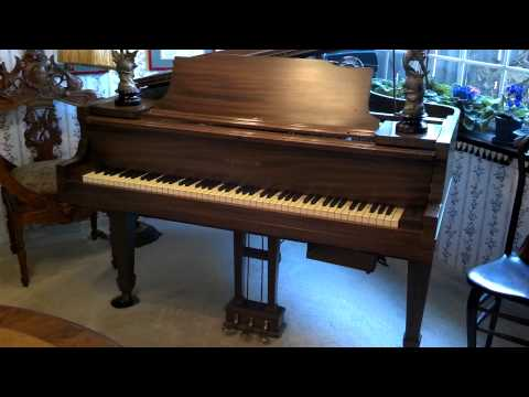 Antique baby grand fitted with a digital Pianocorder player plays Liberace's 'Alley Cat'