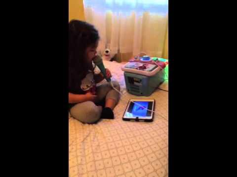 A baby singing karaoke