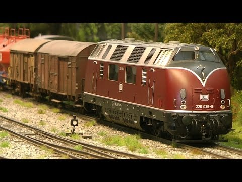 Model trains in O scale with strikingly realistic landscape