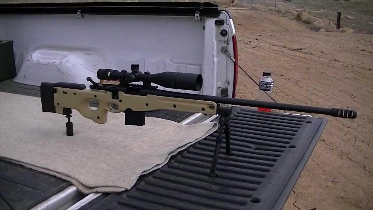 308 Remington 700 ~ 1012 yard shot at a gallon of milk - YouTube