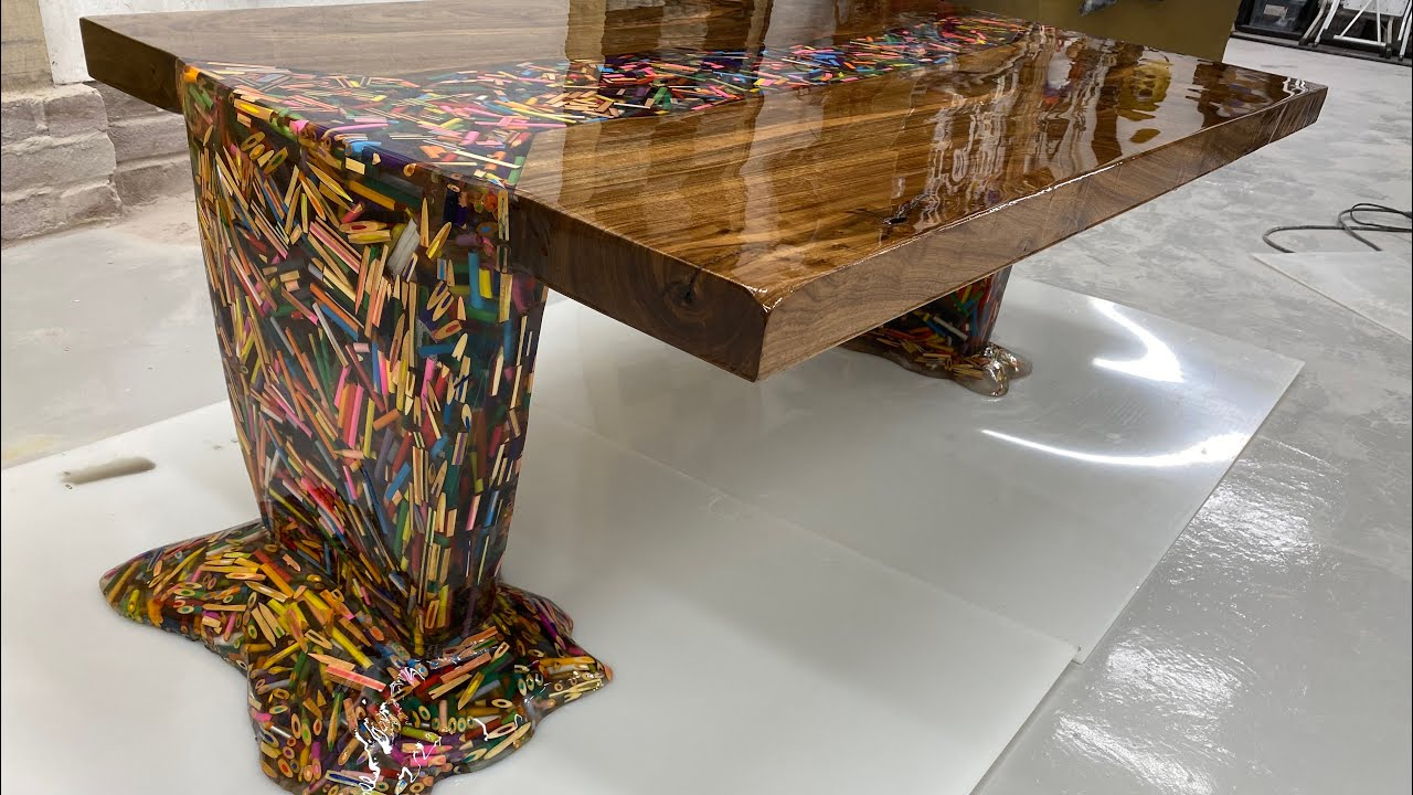 Download Thousands of Pencils Floating Down a River Table..