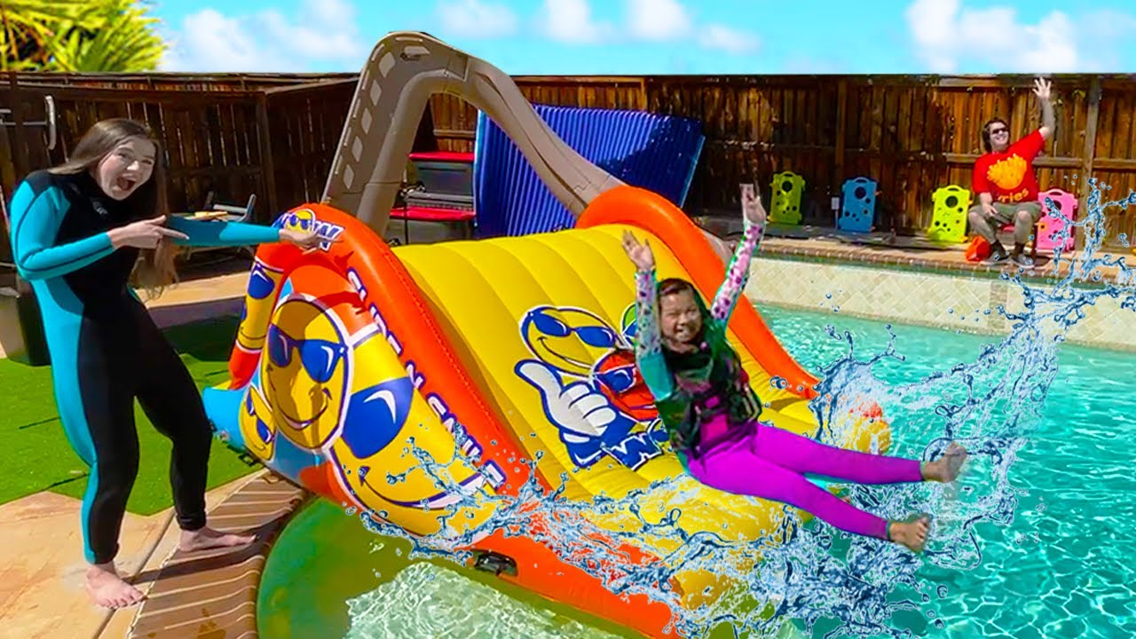 Emma and Ellie Pretend Play Going Swimming in the Pool with Giant Inflatable Slide