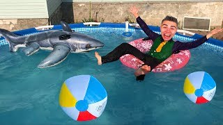 Diver Mr. Joe on Chevrolet Camaro swimming in POOL with Shark on Inflatable Circle for Children