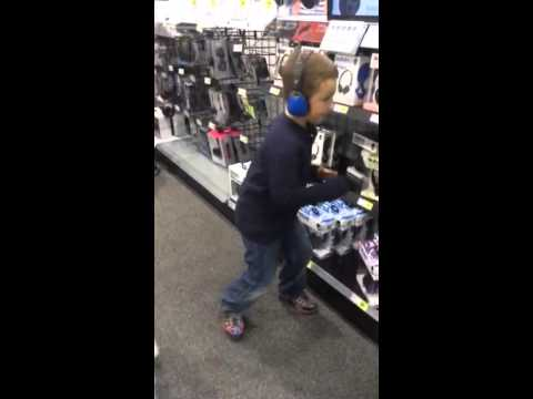 Luke trying out some headphones at best buy