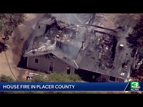 Crews are battling a house fire in Placer County east of Loomis.