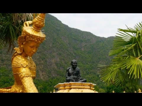 Sculpture of a Golden Angel Against the Background of the Thai Wat | Stock Footage - Videohive