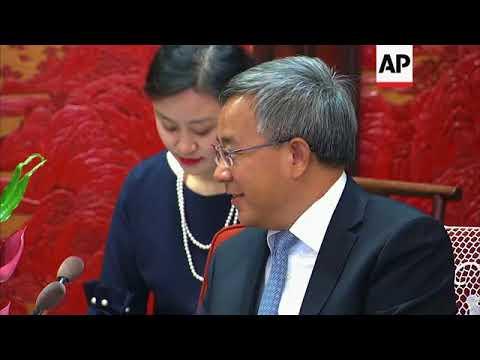 UK Trade Secretary Fox meets Chinese Vice Premier Hu Chunhua in Beijing