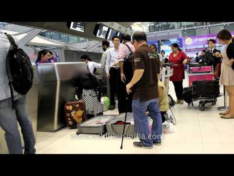 Baggage check-in at Bangkok Airport