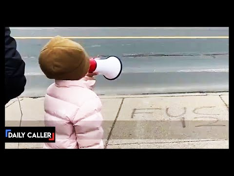 Little Kid Protester Shouts At Police With Megaphone