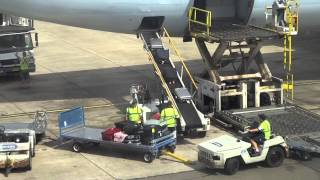 Sydney Airport baggage handlers doing their worst!