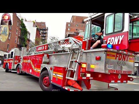 Watch Big Long Fire Truck with Rear-Wheel Steering Back Up - FDNY Ladder 20