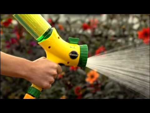 Feeding plants with miracle-Gro all purpose plant food.