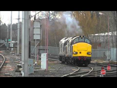 DRS Class 37s 37607 and 37611 at Carlisle Clagging A Bit 10th December 2011.wmv